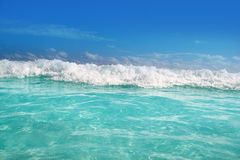 Blue turquoise wave caribbean sea water foam Stock Photo