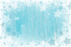 Blue or turquoise wooden christmas background with texture. Blue or turquoise wooden christmas background with texture and white stars royalty free stock image