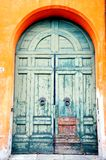 Blue tuscan door in Italy. Traditional tuscan door painted in blue on the streets of Florence in Italy stock photos