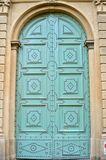 Blue tuscan door in Italy Royalty Free Stock Photo