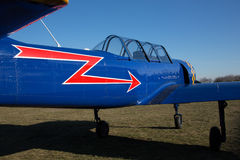 Blue two passangers aircraft with red arrow Stock Photo