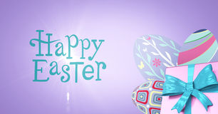 Blue type and pink gift and purple eggs against purple background Royalty Free Stock Photo