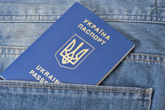 Blue ukrainian passport in pocket of jeans closeup Royalty Free Stock Photo