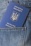 Blue ukrainian passport in pocket of jeans closeup Royalty Free Stock Photo