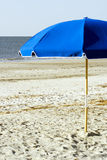 Blue Umbrella on the beach. In front of the water Stock Photos