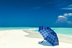 Blue umbrella is on a beach Royalty Free Stock Photos