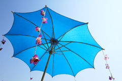 Blue umbrella with blue sky Royalty Free Stock Photography