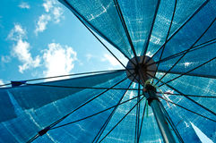 Blue umbrella from bottom view Royalty Free Stock Photos