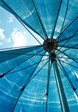 Blue umbrella from bottom view Royalty Free Stock Photography