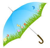 Blue umbrella with grass, flowers and butterflies Royalty Free Stock Image