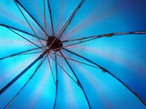 Blue Umbrella. Light shining through translucent blue umbrella Royalty Free Stock Photos