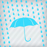 Blue umbrella and rain drops Stock Photos