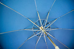 Blue umbrella spokes Royalty Free Stock Photos
