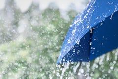 Free Blue Umbrella Under Heavy Rain Against Nature Background. Rainy Weather Concept Royalty Free Stock Photography - 153356297