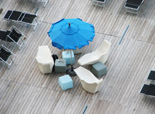 Blue umbrella. And white chairs on a terrace of a cafe stock photos
