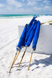 Blue Umbrellas at the Beach Stock Images