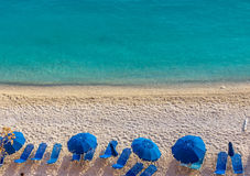 Blue umbrellas and blue sea - Greece, Lefkada island. View of the Blue umbrellas and blue sea - Greece, Lefkada island royalty free stock image