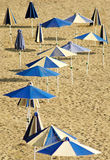Blue umbrellas on the empty beach Royalty Free Stock Photography