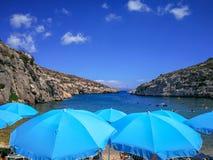 The Blue Umbrellas of Mgarr ix-Xini Gozo. Gozo island Mgarr ix-Xini snorkeling stock images