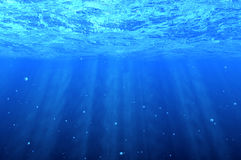 Blue underwater background Stock Photos