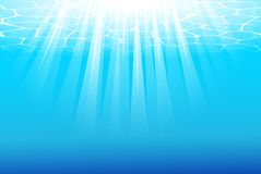 Blue underwater background with sunbeams Royalty Free Stock Images