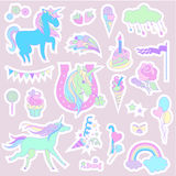 Blue unicorns with candy, flag and fireworks on a beige background. Royalty Free Stock Photos