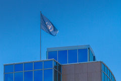 Blue United nations flag on UN building at Geneva, Switzerland Stock Photo
