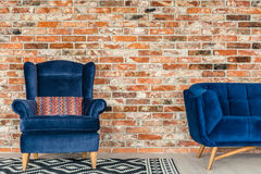 Blue upholstered armchair royalty free stock image