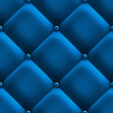 Blue upholstery. Blue stylish fabric with knobs, texture Royalty Free Stock Photography