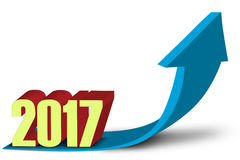 Blue upward arrow and numbers 2017. Image of a blue upward arrow symbolizing business growth with numbers 2017 in the studio Stock Photos