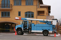 Blue utility truck. With traffic cones in front of a colorful building Stock Photography