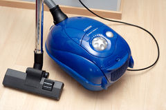 Blue vacuum cleaner Stock Photography