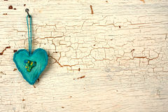 Blue valentines handmade heart on a  white old wooden door. Heart symbol  hand made on a white old wooden background Royalty Free Stock Photo