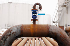 Blue valve on rusty piping Stock Photography