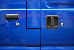 Blue Van. A photo taken on the handles of a blue painted van side doors Royalty Free Stock Photo