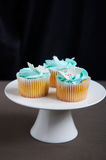 Blue vanilla cupcakes on stand Royalty Free Stock Photo