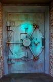 Blue vault door. Bank vault door with blue light shining on it stock photo