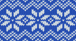 Blue vector realistic knit seamless pattern with white snowflakes and zig zag ornament Stock Photo