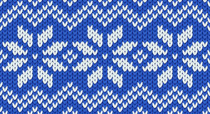 Blue vector realistic knit seamless pattern with white snowflakes and zig zag ornament Royalty Free Stock Photos