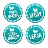 Blue vegan Badge Set. German-Translation: Vegan Button und Vegetarisch Banner Set. Eps10 Vector stock illustration