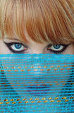 The blue veil. Enticing - blue eyes and a blue veil stock photo