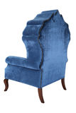 Blue velvet armchair. With high back and short wooden legs, on white background isolated on white. Armchair with fabric upholstery Stock Image