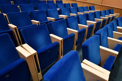 Blue velvet chairs in amphitheater Royalty Free Stock Image