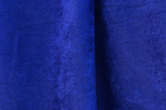 Blue Velvet Fabric Texture. Nice blue fabric velvet background with fold for texture or design Stock Photo