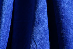 Blue Velvet Fabric Texture. Nice blue fabric velvet background with folds for texture or design Stock Image