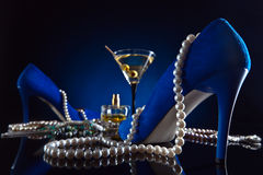 Blue velvet shoes , martini and jewelry Stock Photography