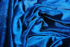 Blue velvet silk fabric wallpaper background. Velvet silk blue abstract art artsy cover closeup texture background. stock images
