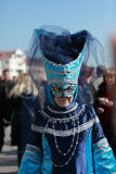 Blue Venetian costume. Venice,Italy-February 26th, 2011: Image of a woman wearing a traditional blue Venetian costume and mask during the Carnival days on Stock Image