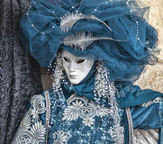 Blue Venetian Disguise. Venice, Italy- February 19th, 2012: Portrait of a person disguised in a blue costume with a white mask during the Venice Carnival days stock images