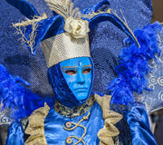 Blue Venetian Disguise. Venice, Italy- February 18th, 2012: Environmental portrait of a person wearing a blue Venetian costume during a the Venice Carnival days stock images